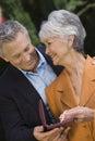 Senior Husband Gifting necklace To Wife Royalty Free Stock Photo
