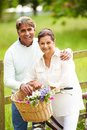 Senior indian couple on cycle ride in countryside close up of happy Stock Photography