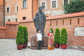 Senior Indian couple taking photo near monument of Pope Saint John Paul II
