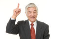 Senior Japanese businessman pointing up Royalty Free Stock Photo