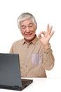 Senior Japanese  man using laptop computer Royalty Free Stock Photo
