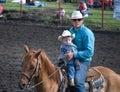 Senior and Junior Cowpokes Royalty Free Stock Photo