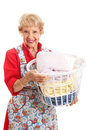 Senior lady does the laundry beautiful woman in her apron doing isolated on white Stock Photography