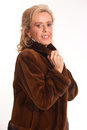 Senior lady in fur portrait of an elegant a mink coat Royalty Free Stock Images