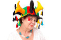 Senior lady with jester s hat mischievous similing to camera happily and mischievously jesters Royalty Free Stock Images