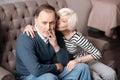 Senior lady kissing her sick husband Royalty Free Stock Photo