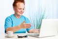 Senior lady pointing to the screen Royalty Free Stock Images