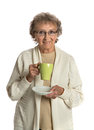 Senior Lady Smiling Holding a Cup of Coffee Stock Images