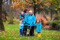Senior lady with walker enjoying family visit happy a or wheel chair and children grandmother and kids a walk in the park child Royalty Free Stock Photos