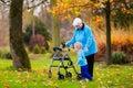 Senior lady with walker enjoying family visit