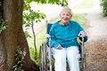 Senior Lady in Wheelchair Smiling Royalty Free Stock Photo