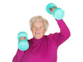 Senior lady working out with weights Stock Image