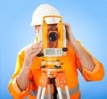Senior land surveyor with theodolite Stock Photo