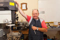 Senior machinist workshop happy in Stock Photography