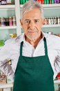Senior male owner standing in grocery store portrait of confident Stock Photography