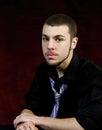 Senior male portrait burgandy background student Royalty Free Stock Photo