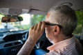 Senior man adjusting sunglasses in car Royalty Free Stock Photo