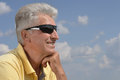 Senior man on background of sky Royalty Free Stock Photo