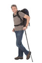 Senior man with backpack and hiking poles Royalty Free Stock Image