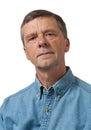 Senior man in blue shirt looks pensive Royalty Free Stock Photo