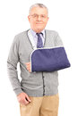 A senior man with broken arm posing Stock Images