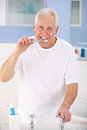 Senior man brushing teeth Royalty Free Stock Image