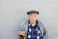 Senior man in checkered jacket at wall Royalty Free Stock Photo