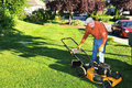Senior Man Cutting Grass Royalty Free Stock Photo