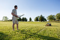Senior man cutting grass with shears Royalty Free Stock Photography