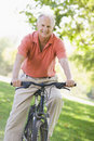 Senior man on cycle ride Stock Image
