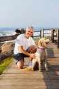 Senior man dog active and his pet at the beach in the morning Royalty Free Stock Photography