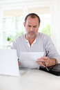 Senior man doing paperwork Royalty Free Stock Photo