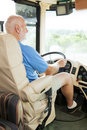 Senior Man Drives Motor Home Stock Image