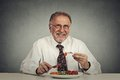 Senior man eating fresh vegetable salad Royalty Free Stock Photo