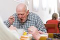 Senior man eating a healthy meal Royalty Free Stock Image