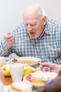 Senior man eating a healthy meal Royalty Free Stock Photo