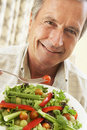 Senior Man Eating A Healthy Salad Royalty Free Stock Photo