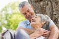 Senior man embracing woman from behind at park closeup of a happy men women the Stock Photography