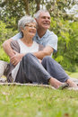 Senior man embracing woman from behind at park happy men women the Royalty Free Stock Photos