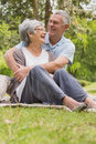 Senior man embracing woman from behind at park happy men women the Royalty Free Stock Images