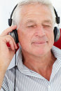 Senior man enjoying music Royalty Free Stock Photography