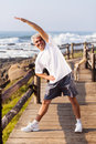 Senior man exercise happy doing morning at the beach Royalty Free Stock Image