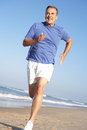 Senior Man Exercising On Beach Stock Image