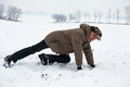 Senior man exercising on snow active in winter Royalty Free Stock Photography