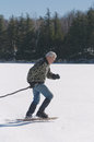 Senior man exercising snowshoes lake winter Stock Image