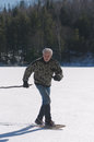Senior man exercising snowshoes lake winter Stock Photography