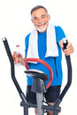 Senior man exercising on stepper Stock Images