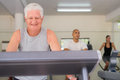 Senior man exercising in wellness club Royalty Free Stock Images