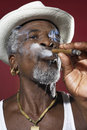 Senior Man In Fedora Smoking Cigar Royalty Free Stock Photo