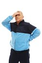 Senior man feeling headache in training suit migraines Stock Photos